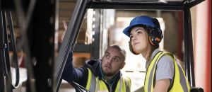 Girl driving a fork lift